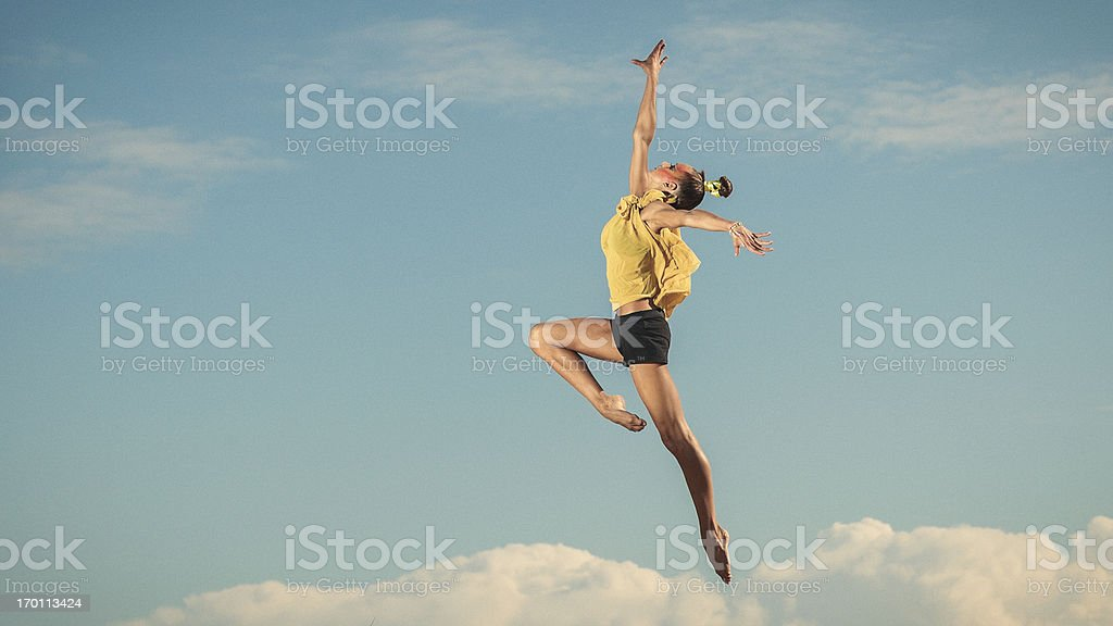 Attractive young female gymnast stock photo