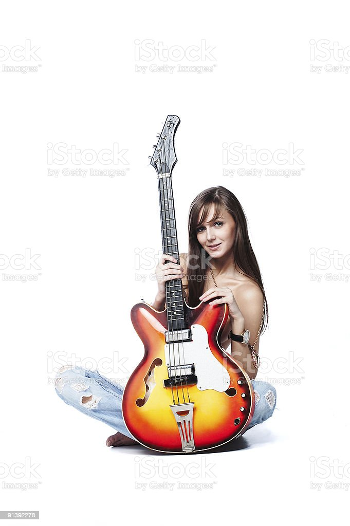 Attractive young female topless holding a guitar stock photo