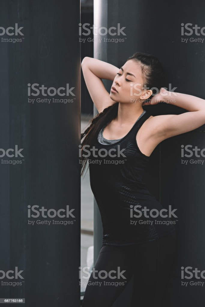 Attractive young fitness woman in sportswear posing on stadium stock photo