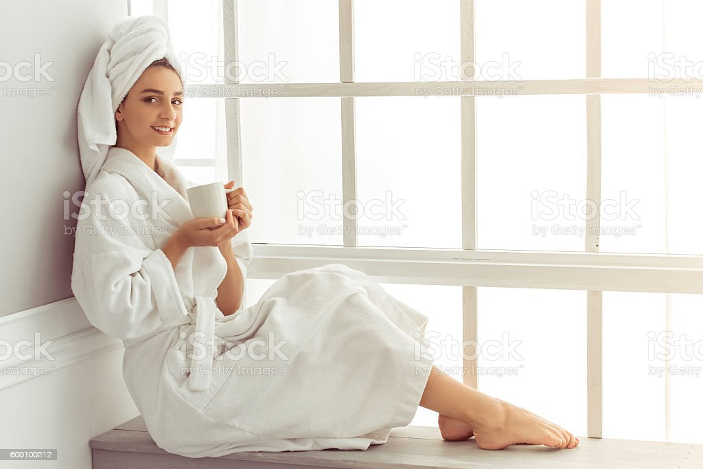 Attractive young girl at home stock photo