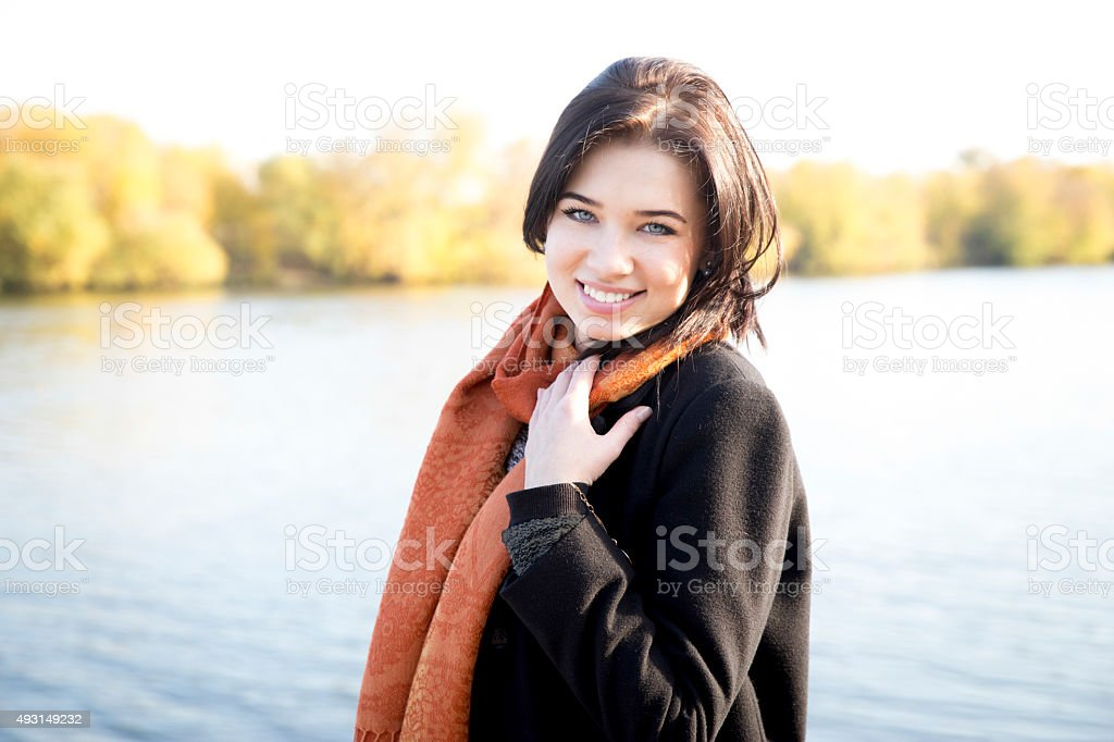 Attractive young girl in a park in autumn stock photo