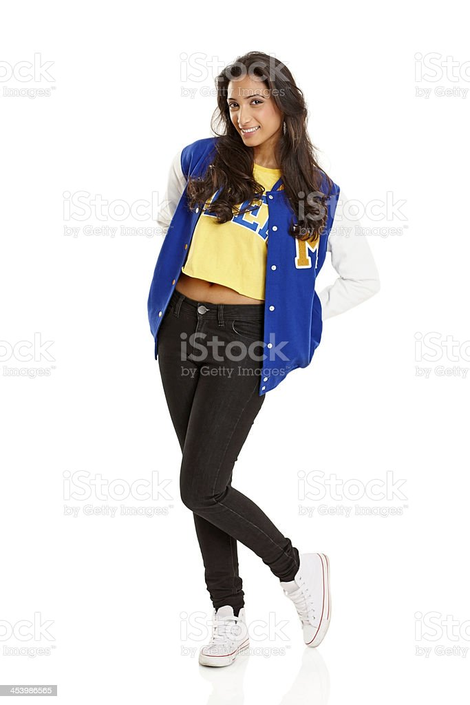 Attractive young girl posing in letterman jacket stock photo