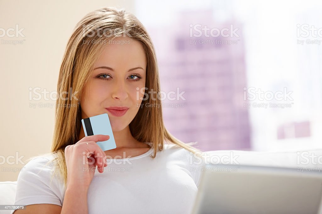 Attractive young girl shopping online with credit card royalty-free stock photo