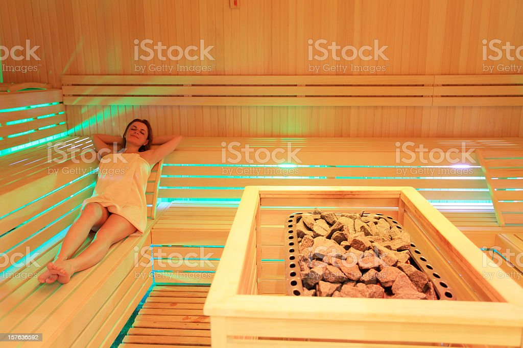 Attractive young girl spends her spare time in the sauna. royalty-free stock photo