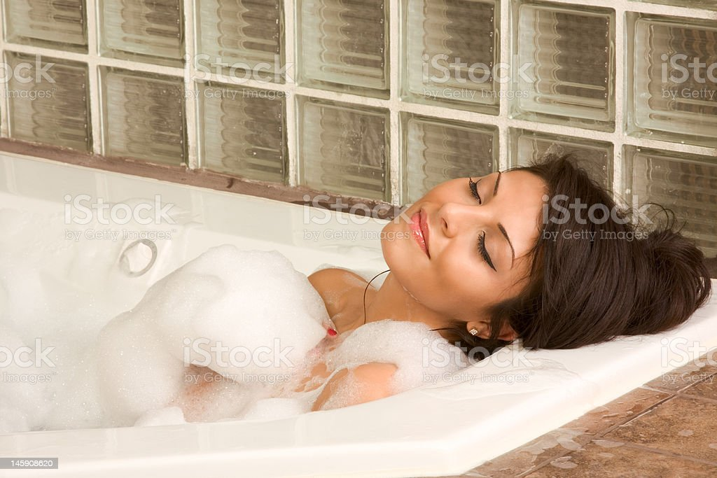 Attractive young gorges female taking bath royalty-free stock photo
