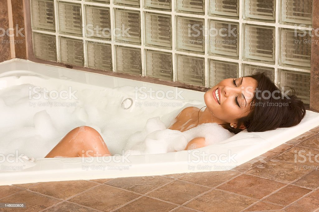 Attractive young gorges woman taking bath royalty-free stock photo