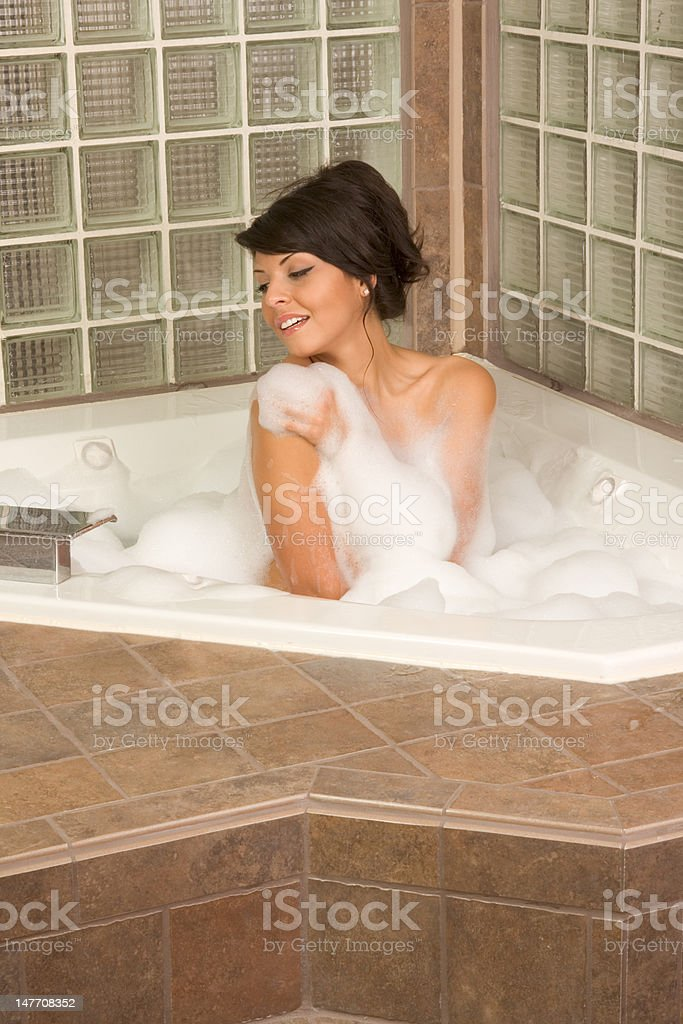 Attractive young gorges woman taking Bubble bath royalty-free stock photo