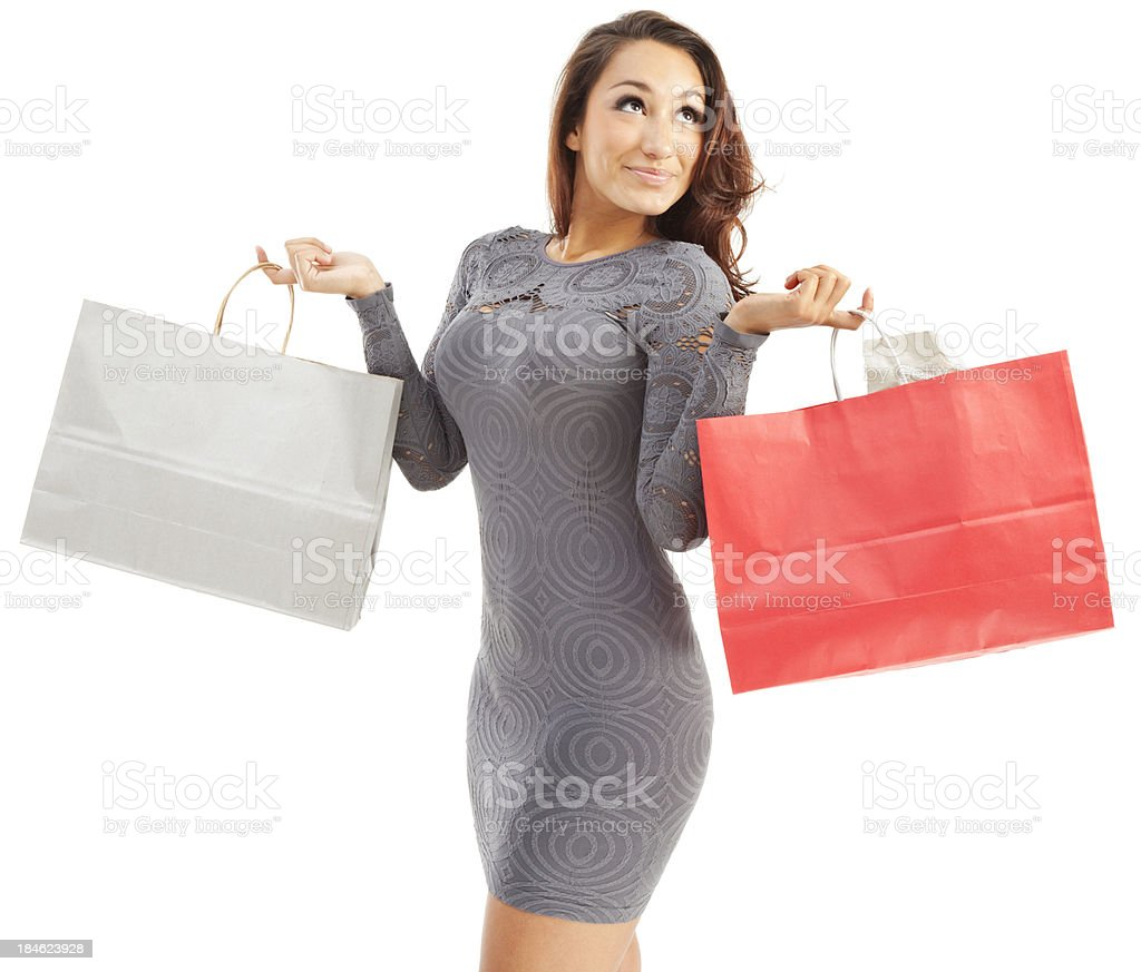 Attractive Young Hispanic Woman with Paper Shopping Bags stock photo