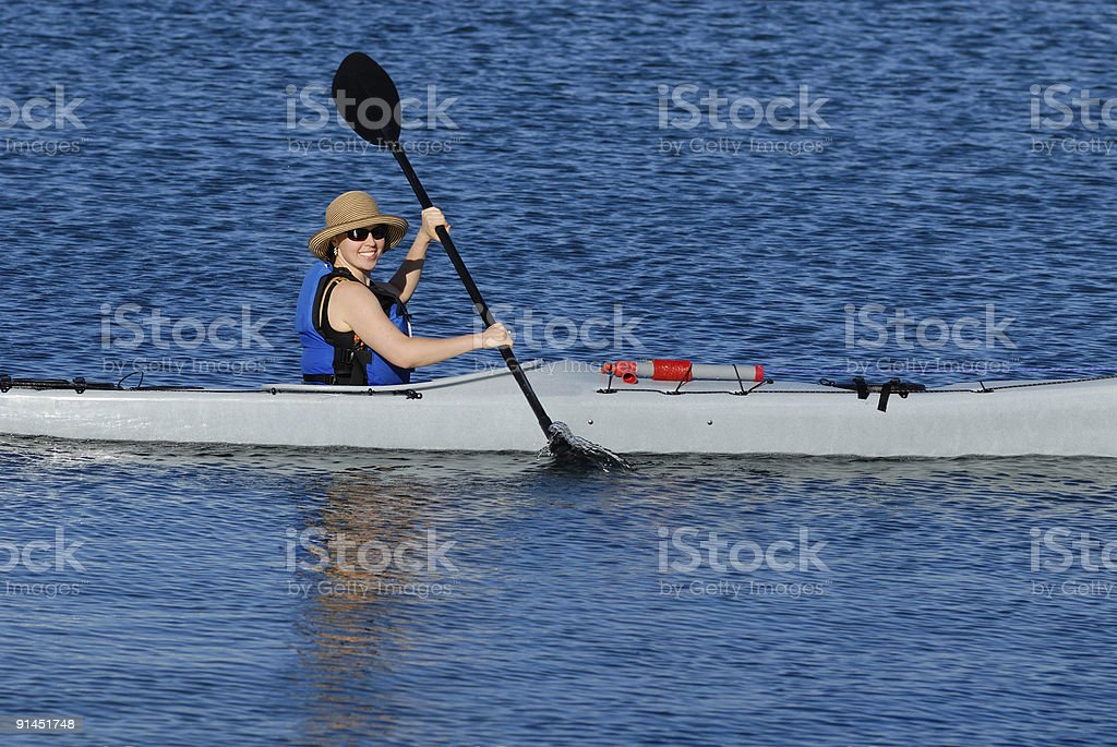 Attractive young lady in a kayak 2 royalty-free stock photo