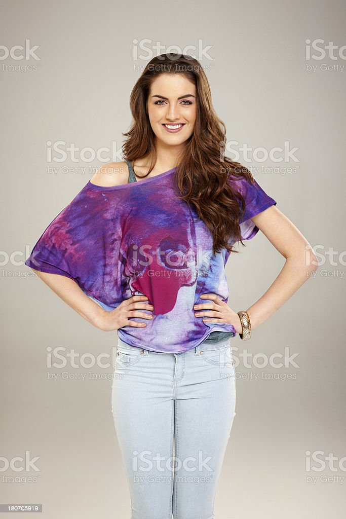 Attractive young lady posing on grey background royalty-free stock photo