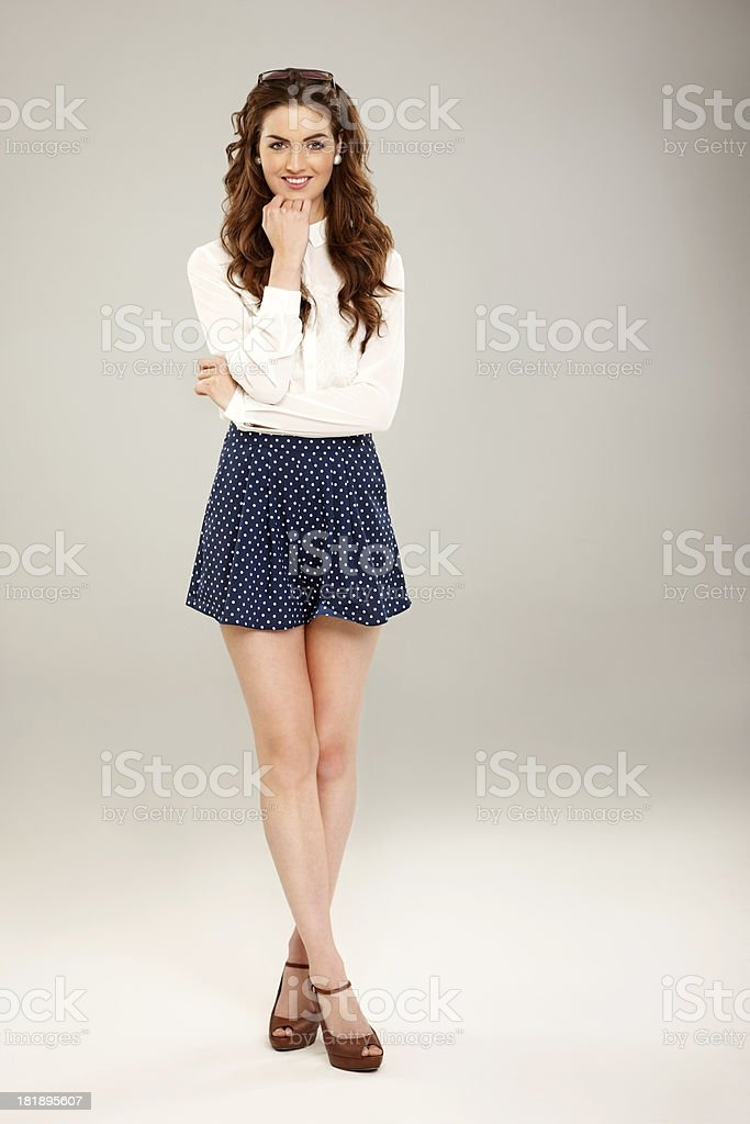 Attractive young lady posing over grey background stock photo