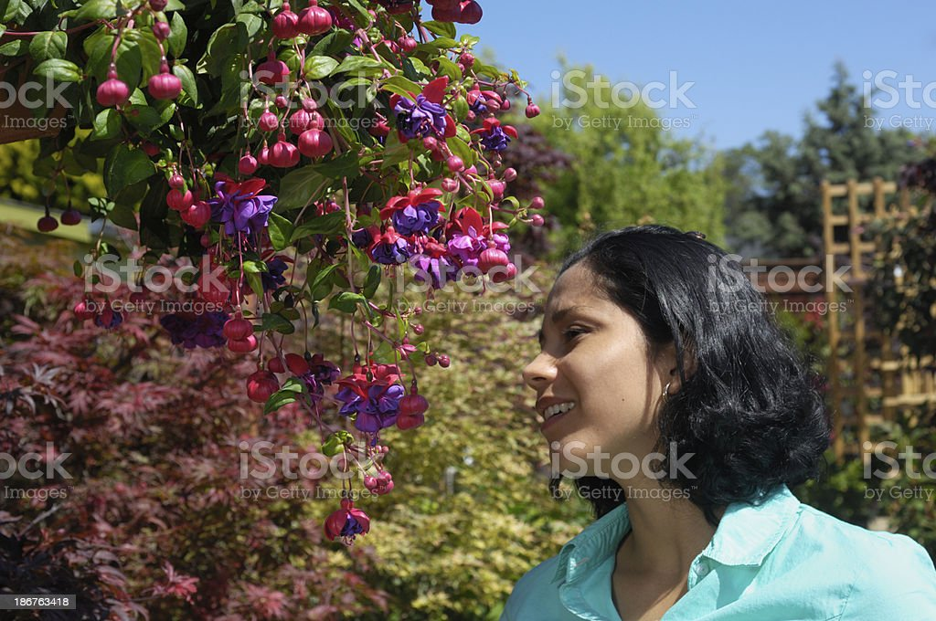 Attractive Young Latina Woman Shopping for Plants royalty-free stock photo