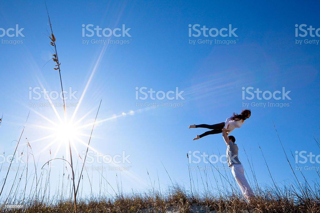 Attractive young man and woman body balancing royalty-free stock photo