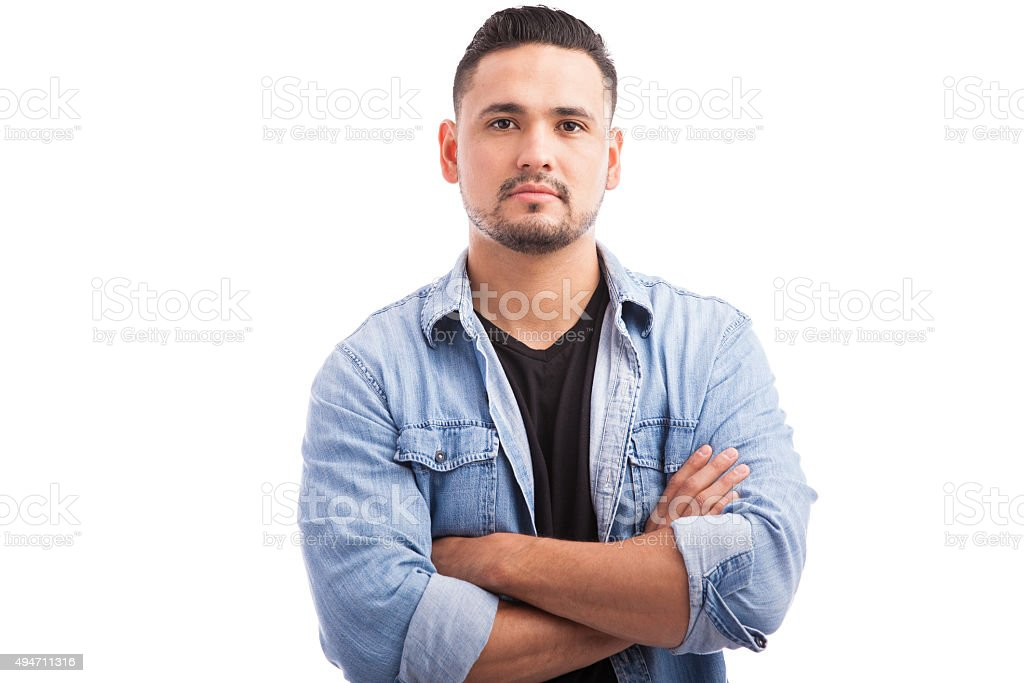 Attractive young man in a studio stock photo