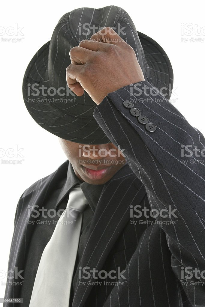 Attractive Young Man In Pinstripe Suit Tipping His Hat royalty-free stock photo