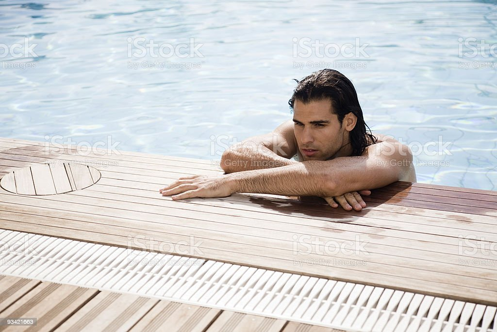Attractive Young Man in the Pool royalty-free stock photo