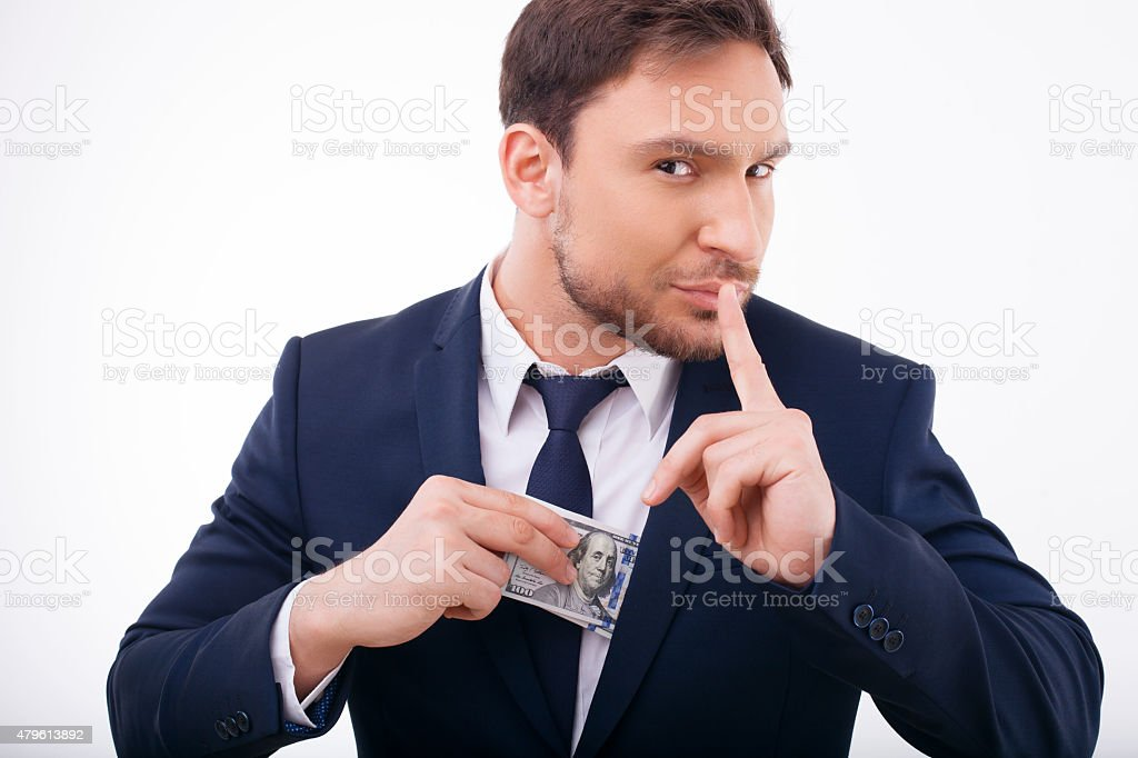 Attractive young man is keeping away his savings stock photo