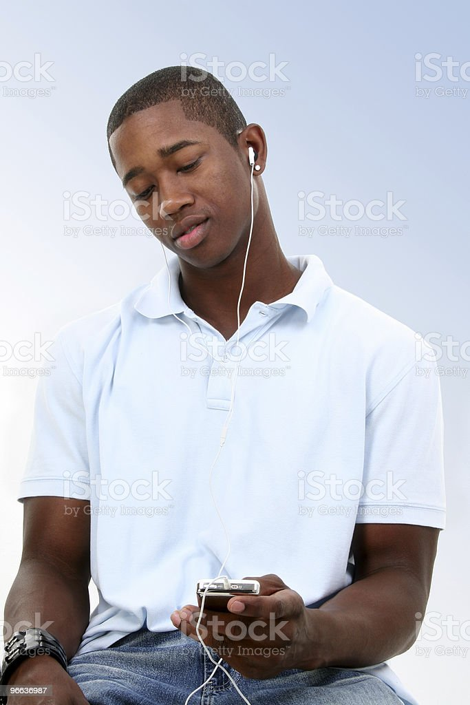 Attractive Young Man Listening To Headphones royalty-free stock photo