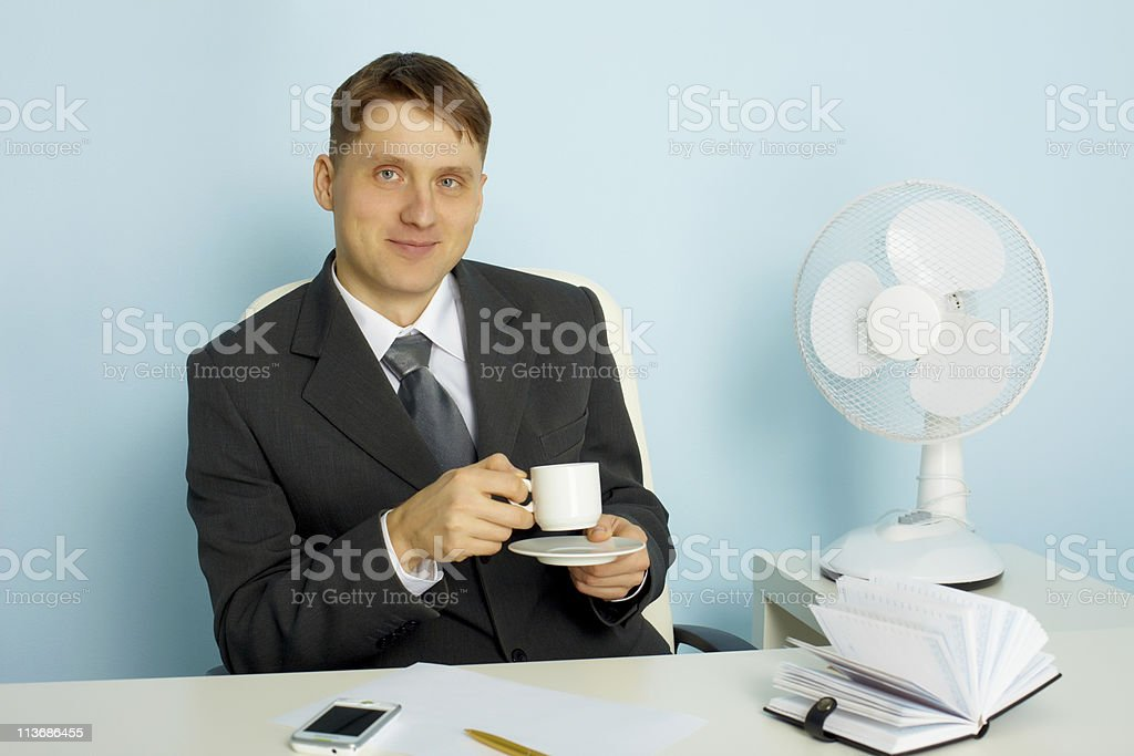 Attractive young man with a cup of coffee royalty-free stock photo