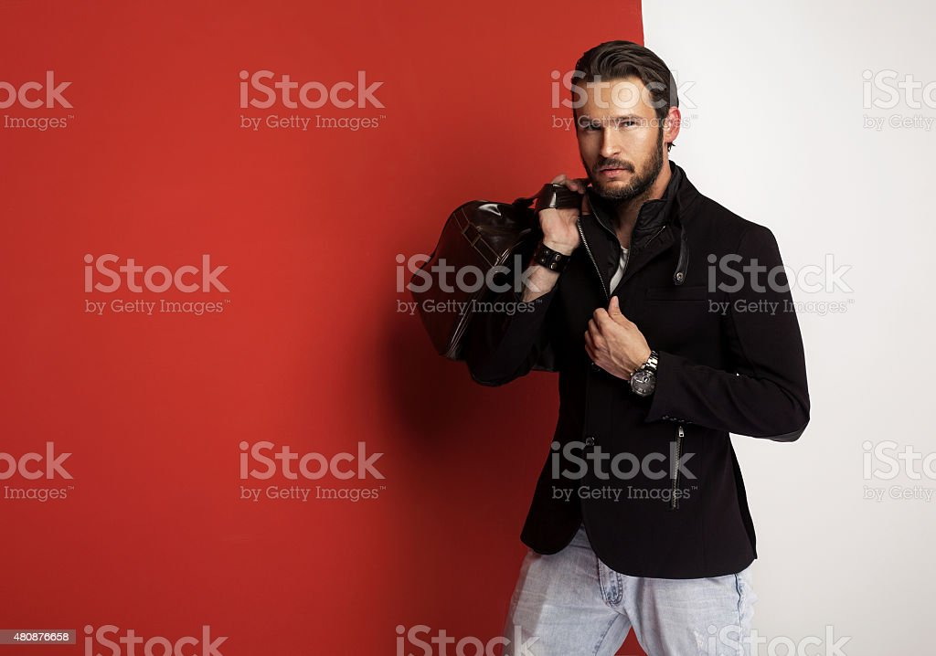 Attractive young man with case stock photo