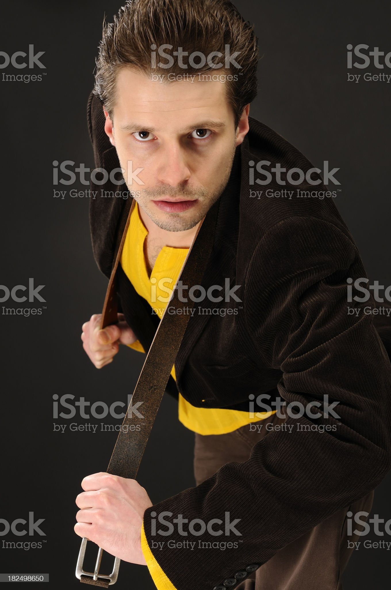 Attractive young man with jacket and belt royalty-free stock photo