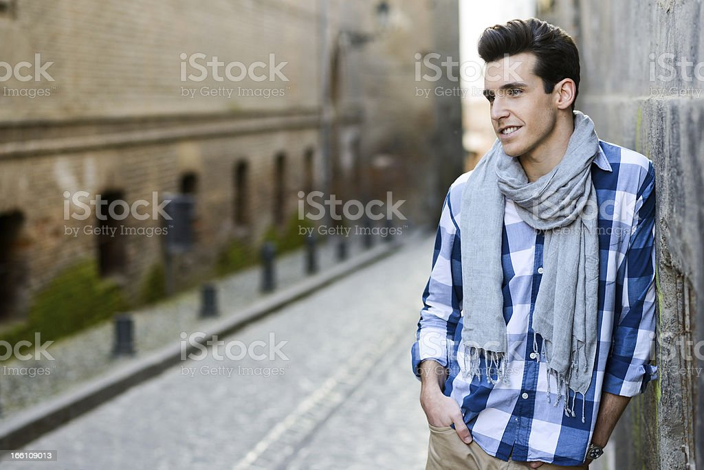Attractive young man with modern haircut in urban background stock photo