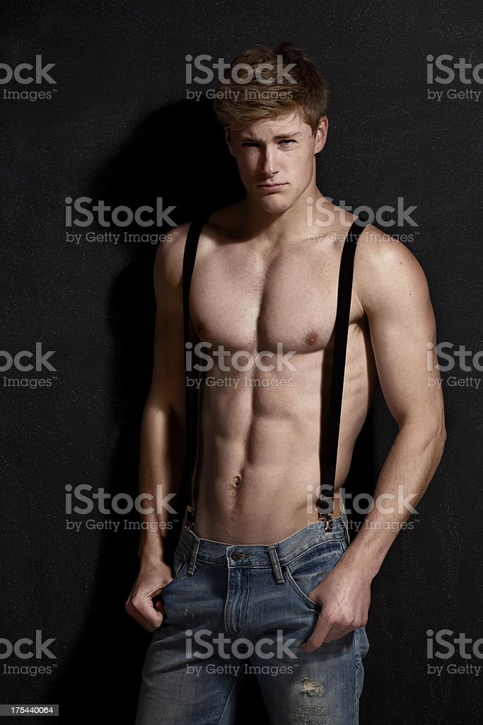 Attractive young man with suspenders royalty-free stock photo