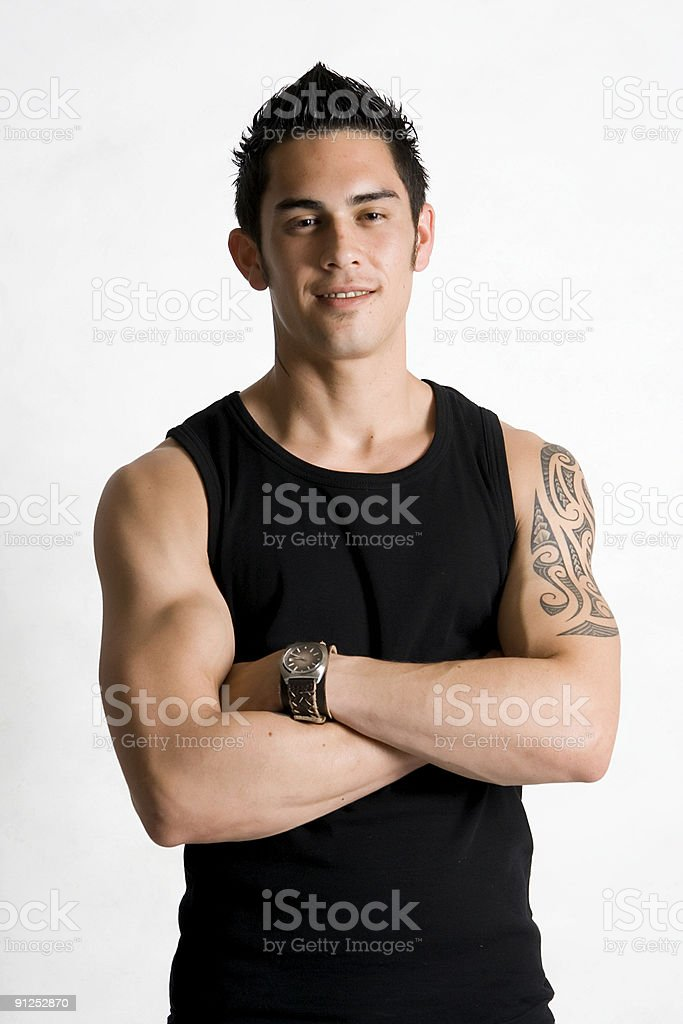 Attractive young man with tattoo stock photo