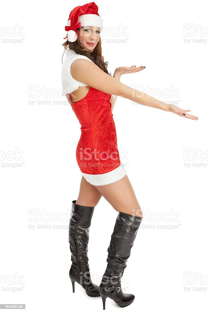 Attractive Young Miss Santa Presenting Blank Space royalty-free stock photo