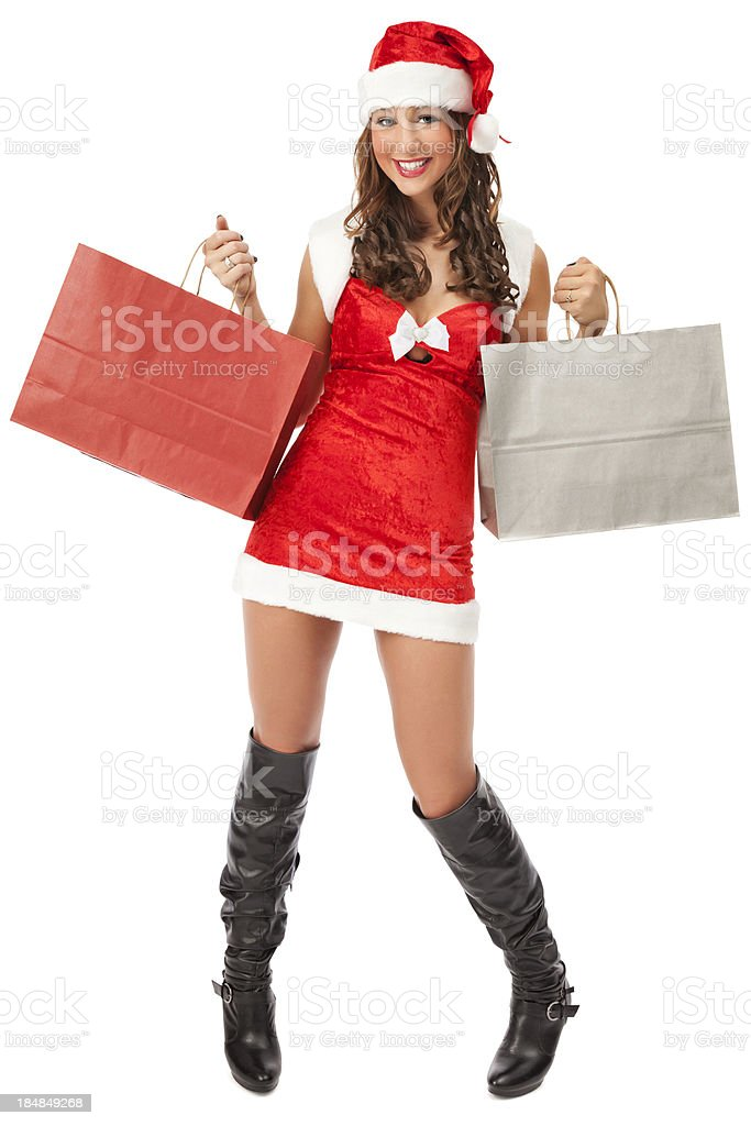 Attractive Young Miss Santa with Paper Shopping Bags royalty-free stock photo