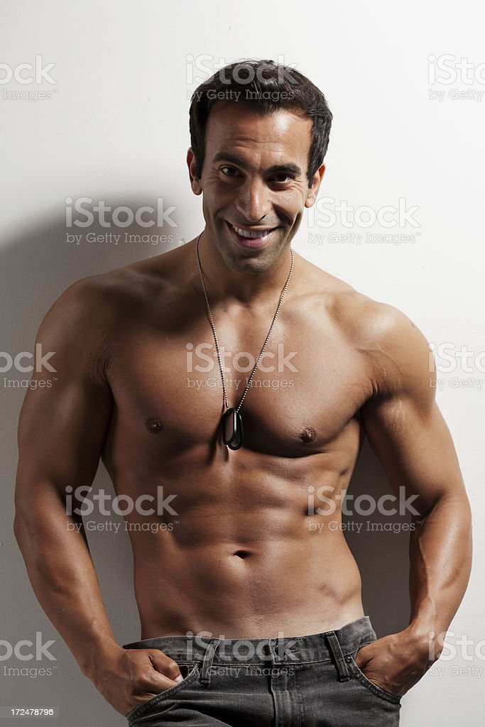 Attractive young muscular man posing royalty-free stock photo