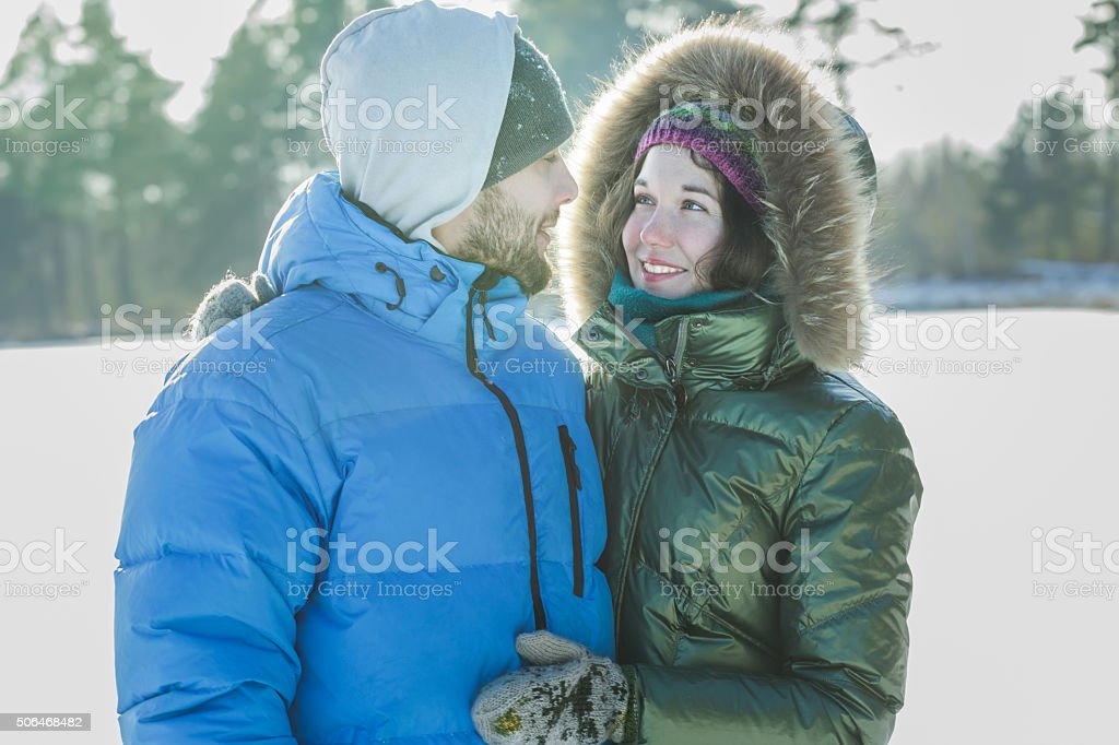 Attractive young people in love looking at each other stock photo