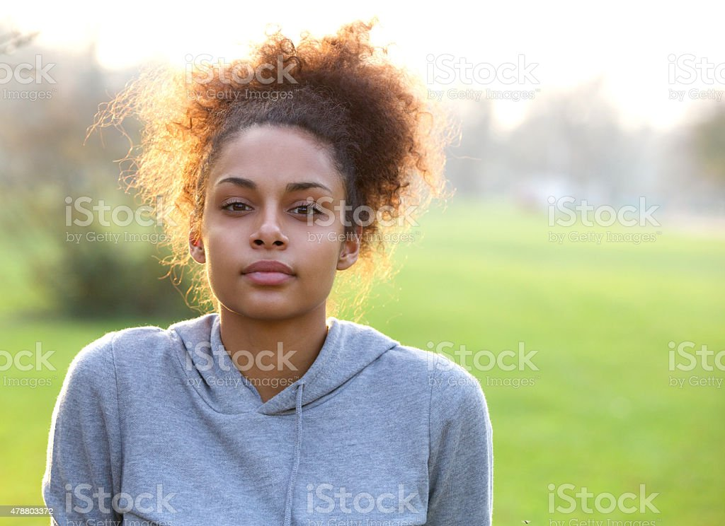 Attractive young sports woman outdoors stock photo
