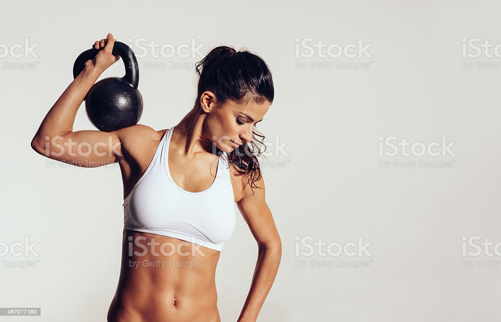 Attractive young with doing gym workout stock photo