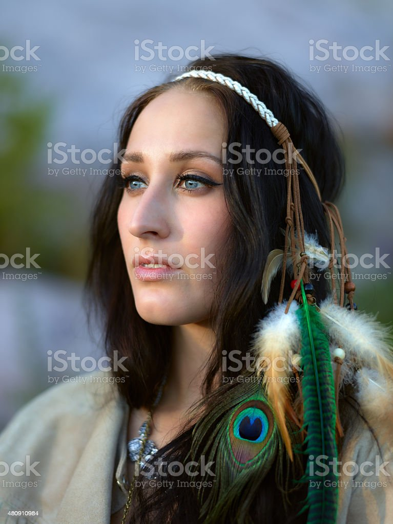 Attractive young woman and feather headpiece stock photo