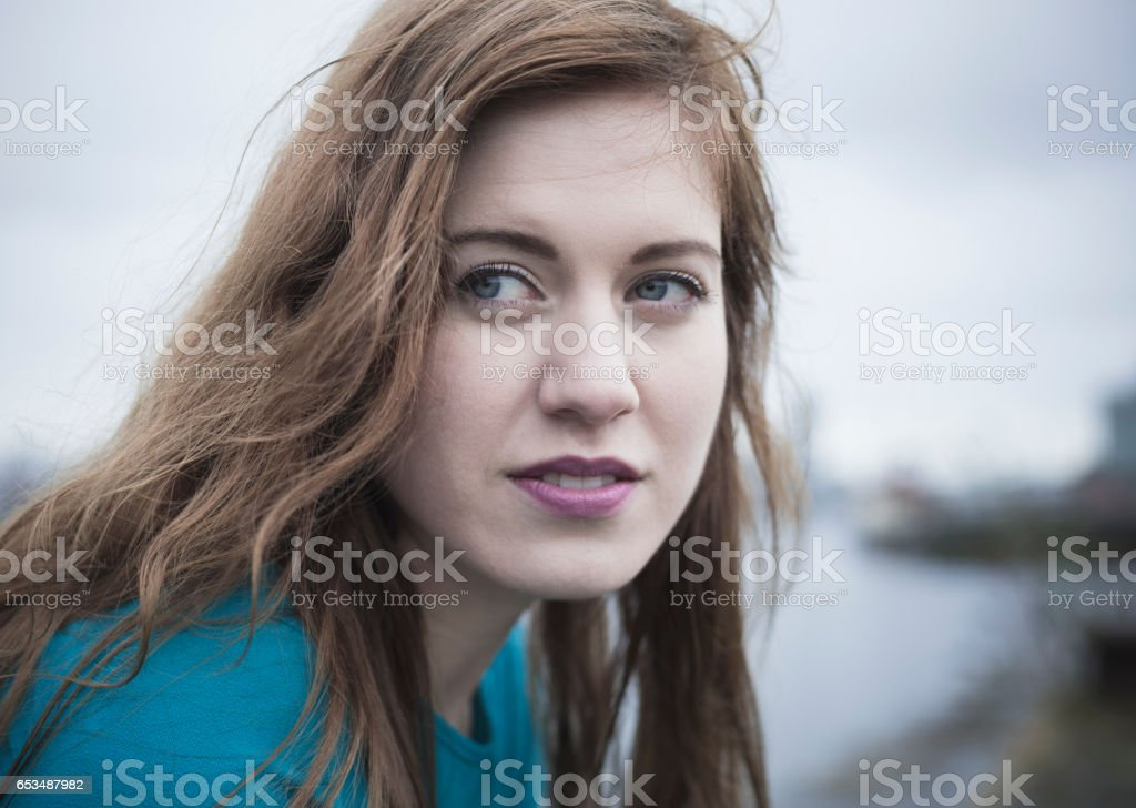 Attractive Young Woman At Derelict Glasgow Docks stock photo