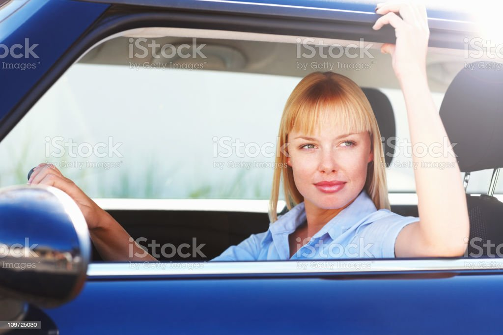 Attractive young woman at front seat of a car royalty-free stock photo