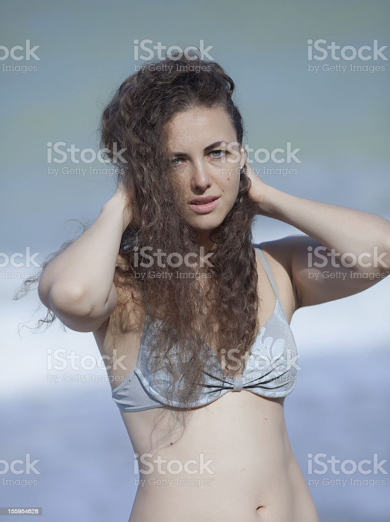 Attractive young woman at the sea royalty-free stock photo