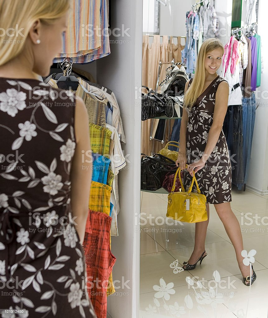 Attractive young woman buying bag in the store. royalty-free stock photo