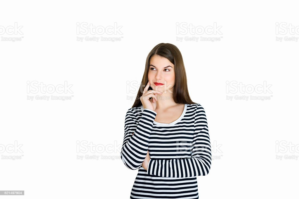Attractive young woman deep in her thoughts, on white background stock photo