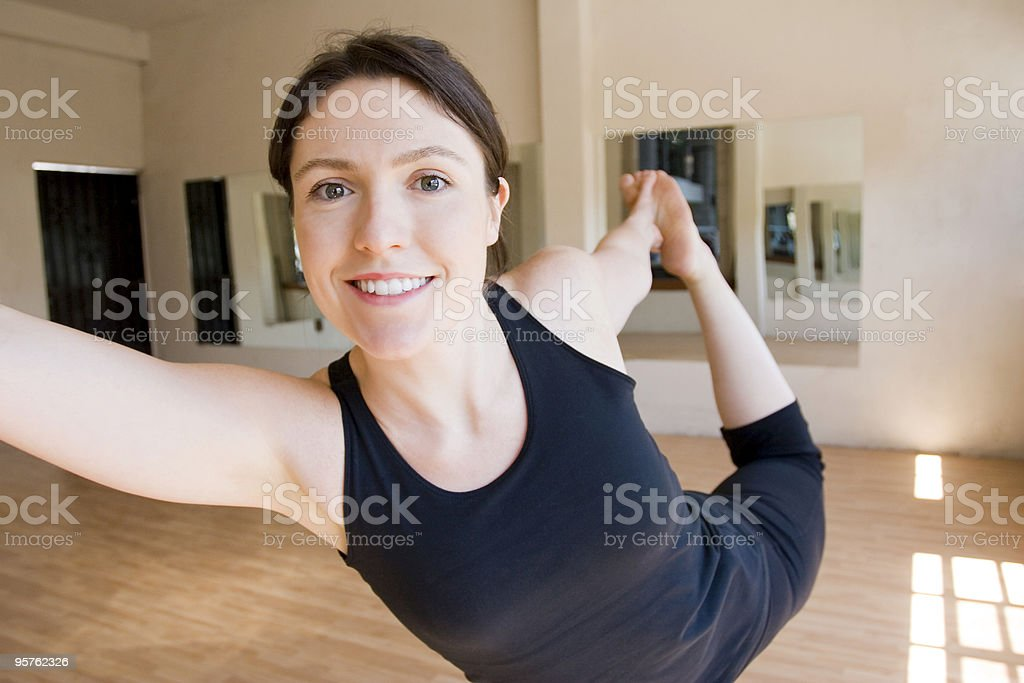 Attractive Young Woman doing Ballet in Gyme and Smiling stock photo