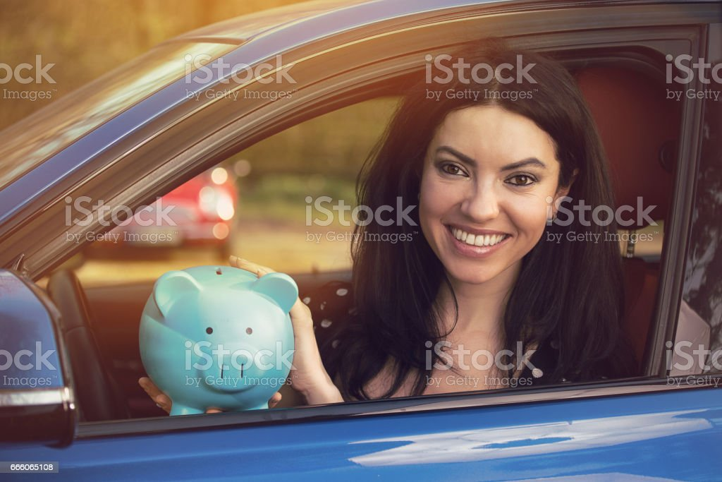 attractive young woman driving her car stock photo