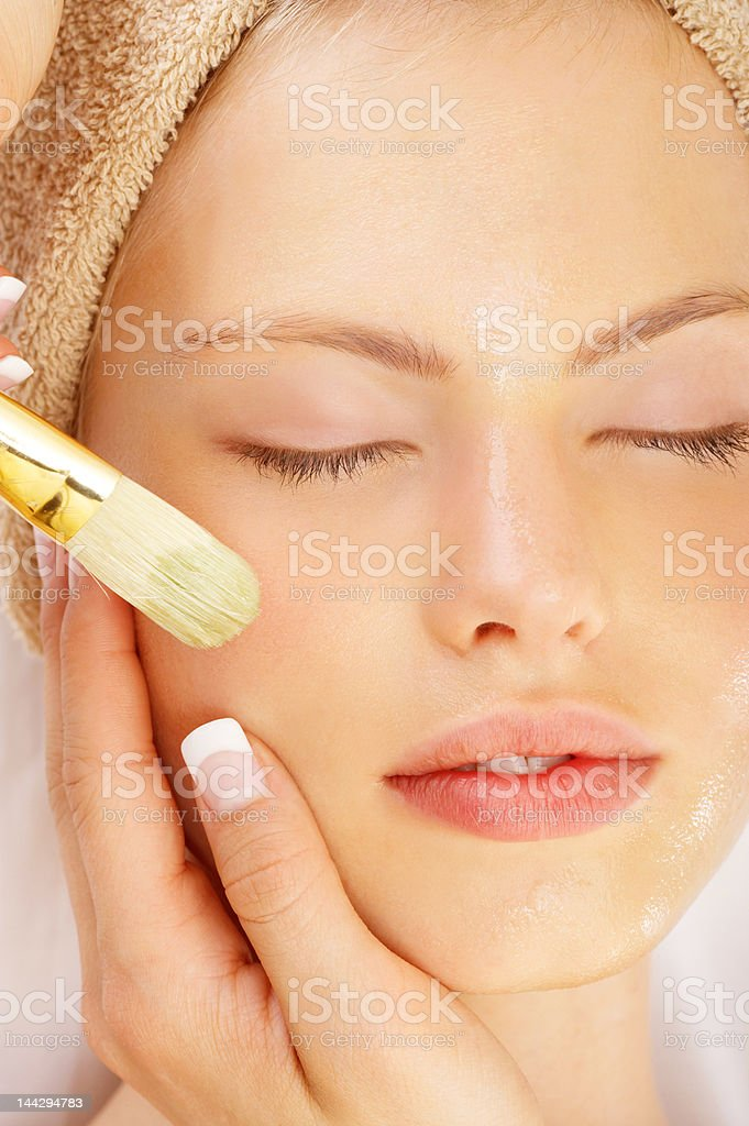 Attractive young woman enjoying a beauty treatment royalty-free stock photo
