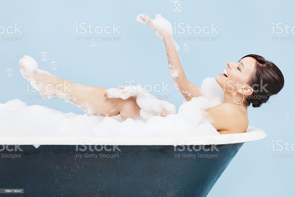 Attractive Young Woman Enjoying a Bubble Bath royalty-free stock photo