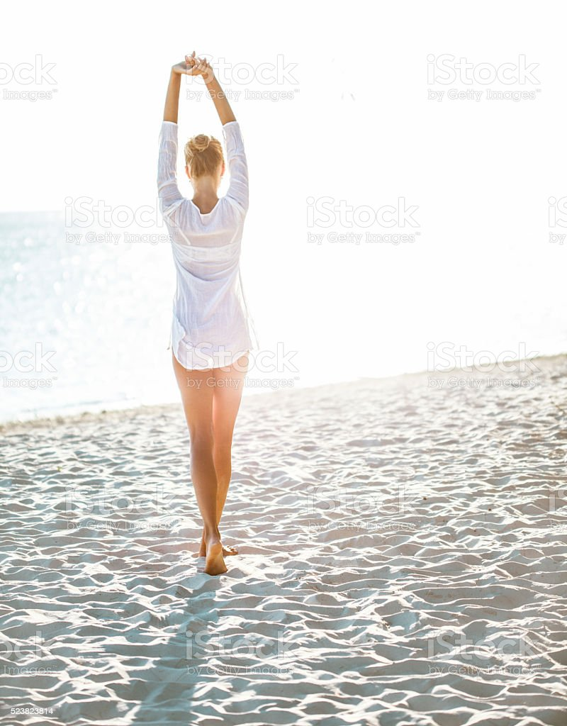 Attractive young woman  enjoying a day at the beach stock photo