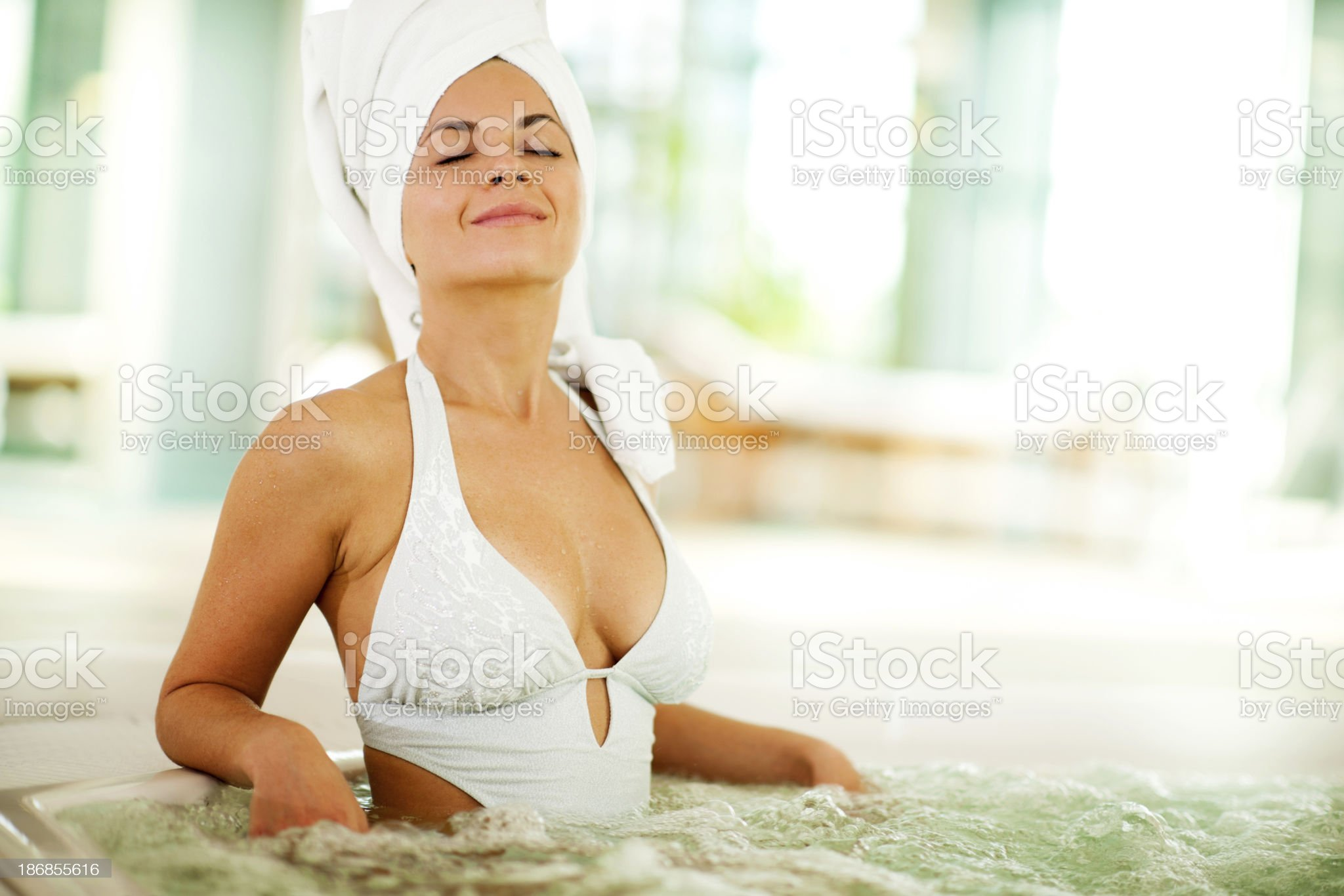 Attractive young woman enjoying herself in the swimming pool. royalty-free stock photo