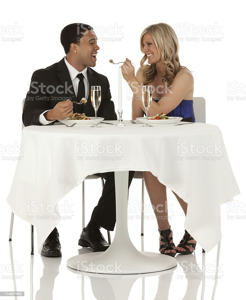 Attractive young woman feeding her boyfriend royalty-free stock photo