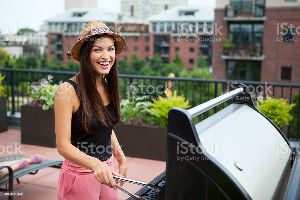 Attractive young woman grilling royalty-free stock photo