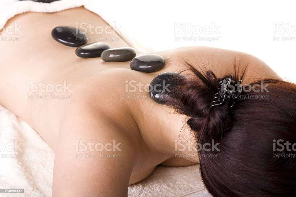 Attractive Young woman having Hot Stone Massage Treatment royalty-free stock photo
