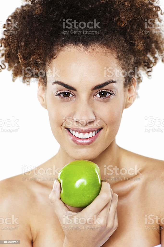 Attractive Young Woman Holding An Apple stock photo